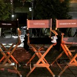 Set chairs with Bruce Willis, Adrian Grenier, and Christopher Rob Bowen.